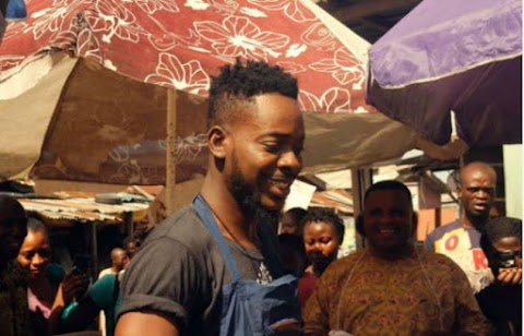 Adekunle Gold Spotted Selling Meat In A Market (pictures)