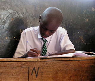 Reading his school book in Tanzania Africa