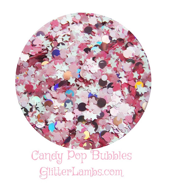 """Our """"Candy Pop Bubbles"""" loose glitter mix has big pink holographic dots, light pink stars, light pink butterflies, pink spades, pink daisies, white stars, and light pink dots."""
