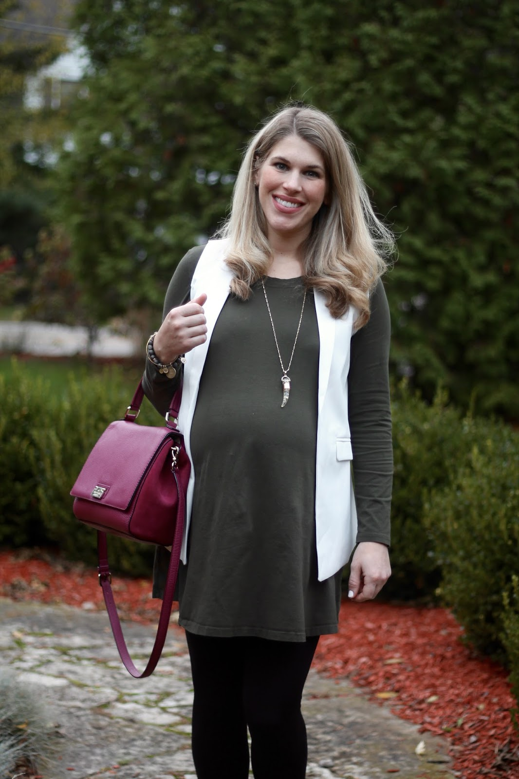 olive dress, black leggings, white sleeveless blazer, plum Kate Spade bag, taupe booties, fall maternity outfit