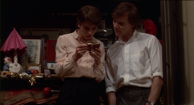 Paul Gallier (Malcolm McDowell) teaches Irena about their family's circus days in CAT PEOPLE (1982)