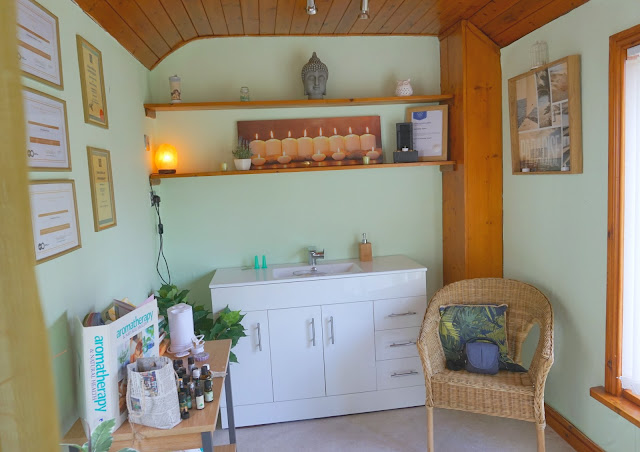 spa treatment waiting room with wicker chair and sink
