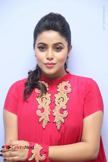 Actress Poorna Latest Stills in Red Dress at Rakshasi First Look Launch  0003.JPG