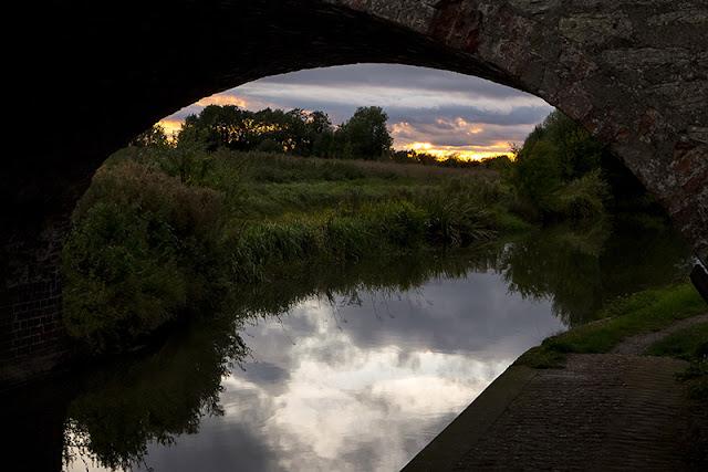 Sunset through a bridge