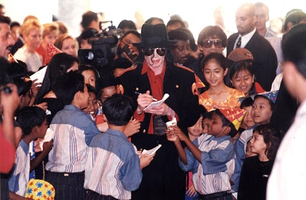 Michael Jackson signs autographs for children at the Concord Hotel in Kuala Lumpur