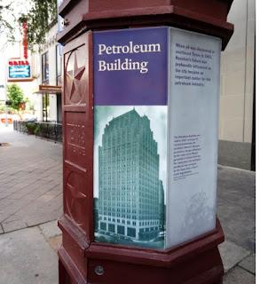 Petroleum Builing - Interpretive Marker with historic photo on sidewalk