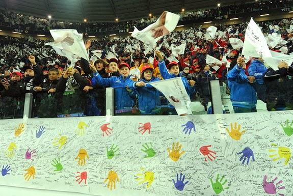 Thousands of children take up the curve where the Juventus ultras usually stand