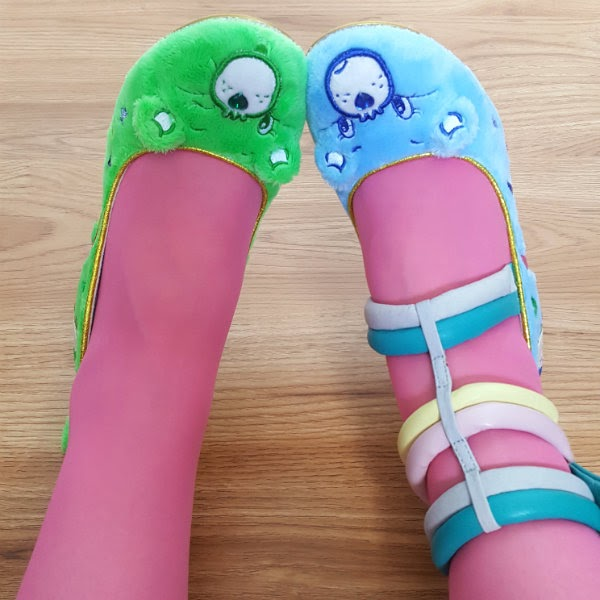 green good luck bear shoe and blue grumpy bear furry upper with pink tights and pastel ankle cuff