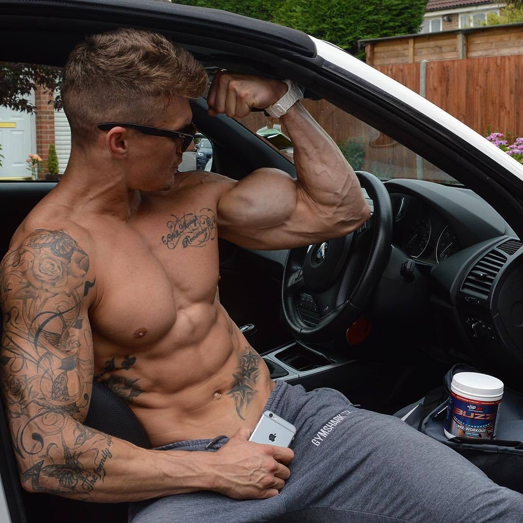 tattooed-sexy-man-car-rock-hard-biceps