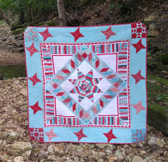 Red and aqua red robin quilt