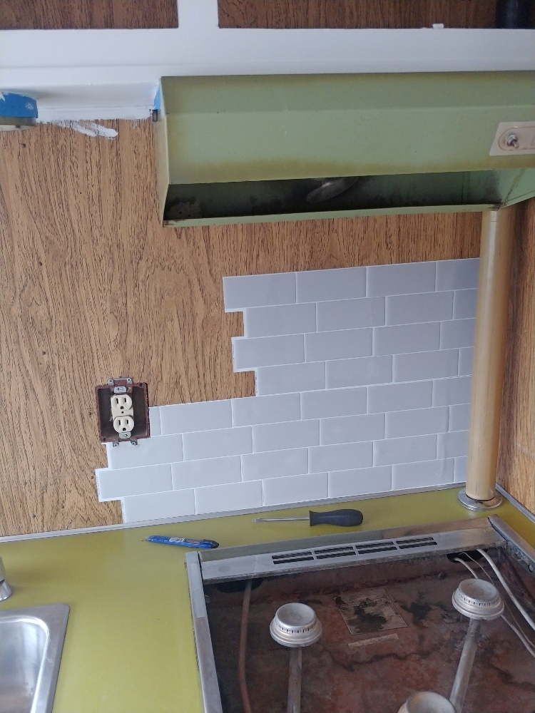 installing self-adhesive smart tiles