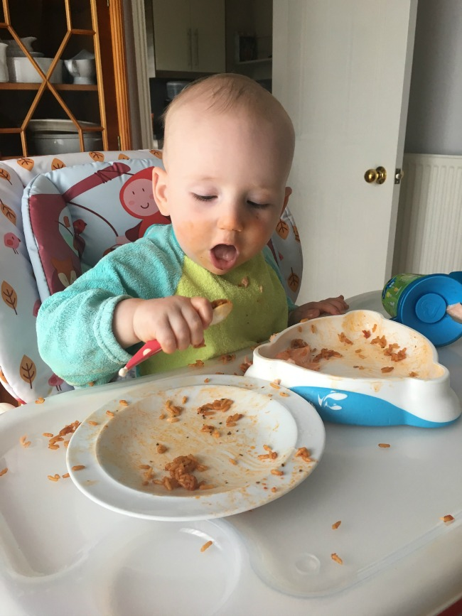 baby-eating-bolognese-sauce-with-spoon-baby-led-weaning-method-BLW