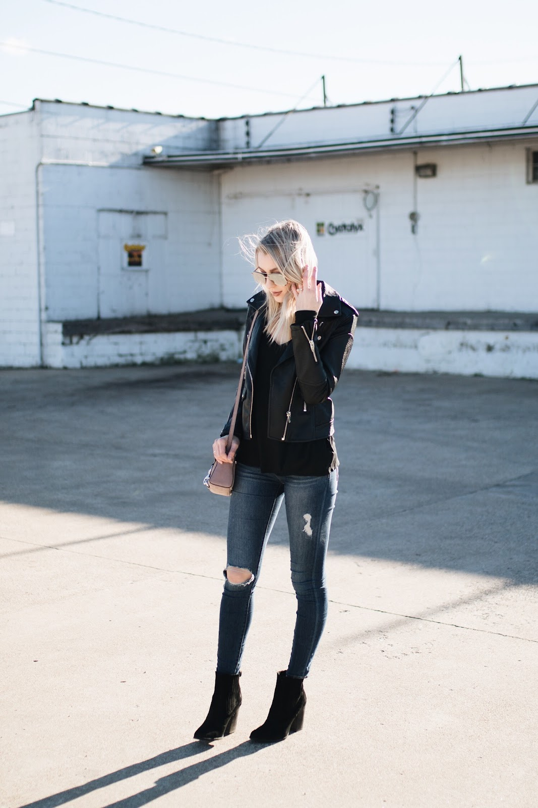 Winter layers with a black faux leather jacket