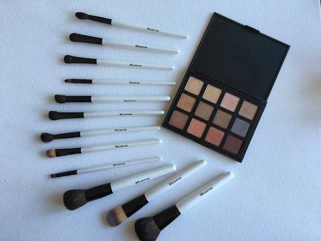 Morphe eyeshadow palette and Morphe makeup brushes on white background