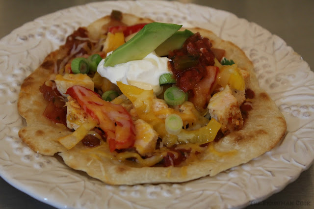flatbread, salsa, cheese, chicken, sour cream, avocado, peppers, onions