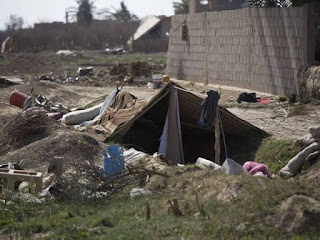 A tent is pitched over a trench left behind by Islamic State militants, in Baghouz, Syria, as U.-S.-backed Syrian Democratic forces continued their push to eradicate the militants from Syria.