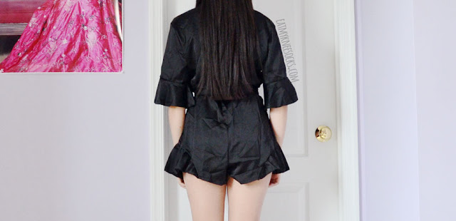 Black ruffled silky satin v-neck plunging wrap front romper from Romwe, with a matching choker that can also be worn as a belt.