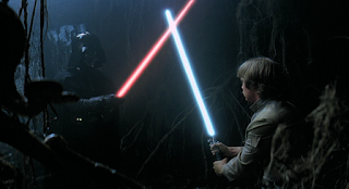 Luke faces Vader in the Dagobah dark side cave.