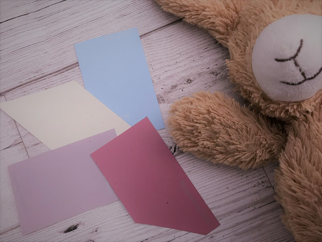 Colour charts laid out next to a cuddly bunny