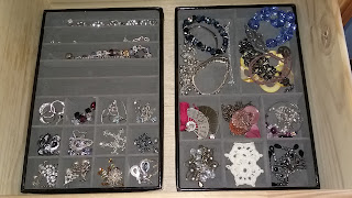 costume jewelry in jewelry trays