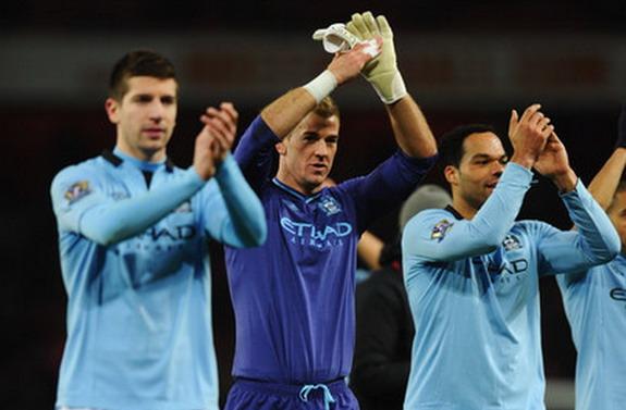 Matija Nastasić, Joe Hart and Joleon Lescott of Manchester City applaud the travelling fans