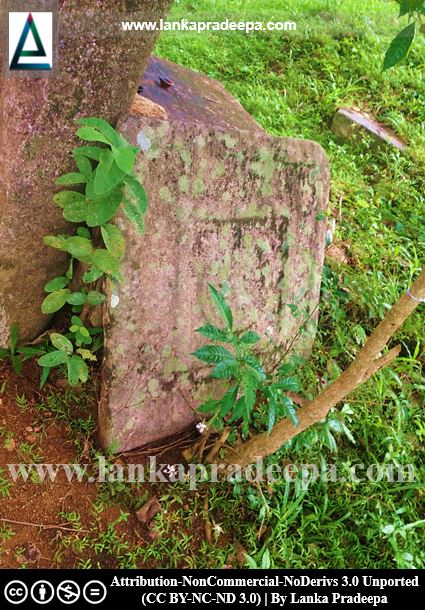 A carved stone slab at Padiyadora Viharaya