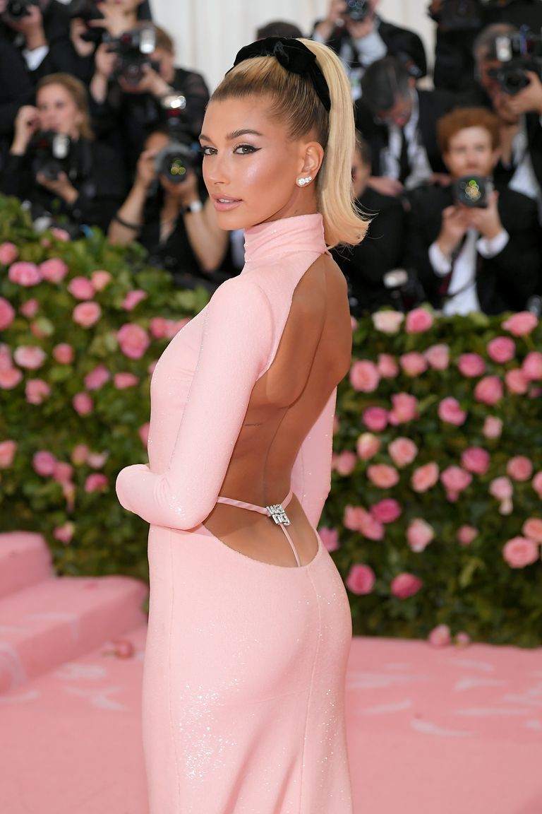 Hailey Baldwin Wore a Millennial Pink Gown With a Bedazzled Whale Tail Sans Justin Bieber at the Met Gala