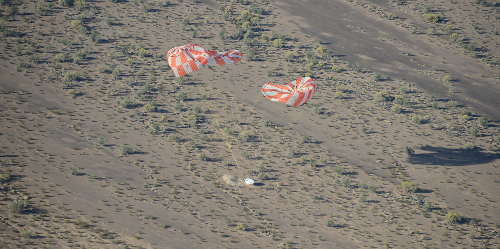Orion's parachutes deflate after a successful touchdown following a test at the U.S. Army's Yuma Proving Ground on April 23. Image Credit: NASA