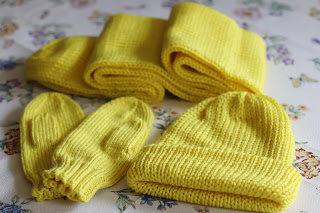 yellow knit hat, mittens, and scarf set