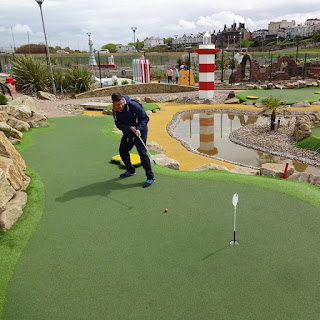 Richard Gottfried playing the Championship Adventure Golf course in New Brighton on National Miniature Golf Day