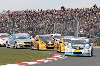Tom Ingram leads away the huge BTCC field in the season opener