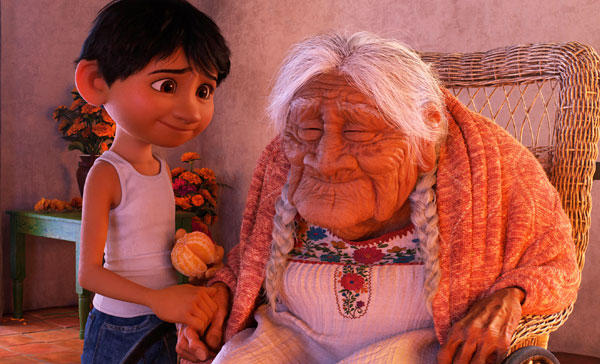 Miguel (Anthony Gonzalez) shows his affection to his grandmother, Mama Coco (Ana Ofelia Murguia) in COCO (2017)