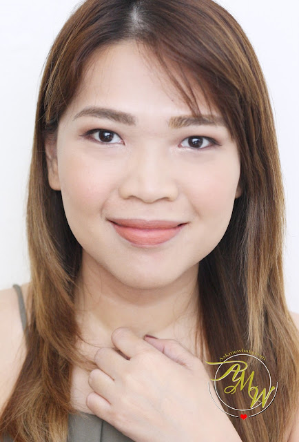 a photo of askmewhats nikki tiu wearing Eden's Paradise Minty Matte Stick Rouge in Bourbon Peach Review