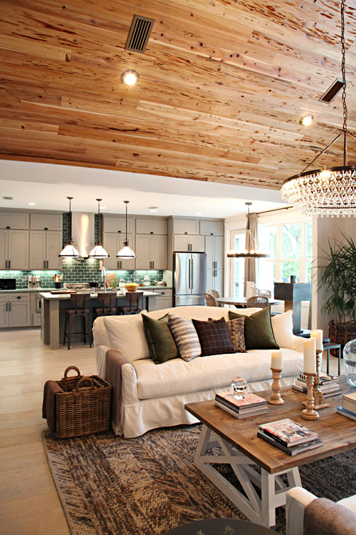 The Main Living Area Is Open To Kitchen Again With A Family Friendly Vibe And Neutral Color Palette Star Of Show Green Backsplash