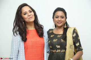 Actress Suma in Black Salwar Suit and Anusuya in orange Dress at winner movie press meet part 1 February 2017 (7).JPG