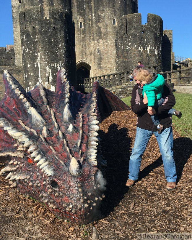Caerphilly-Castle-with-toddler-and-smoking-dragon