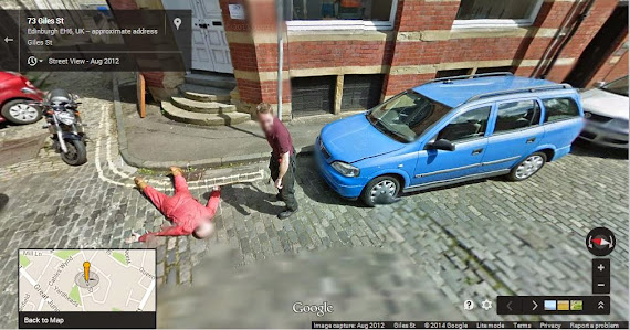 Murder prank on Google Maps. Man standing with axe in his hand.