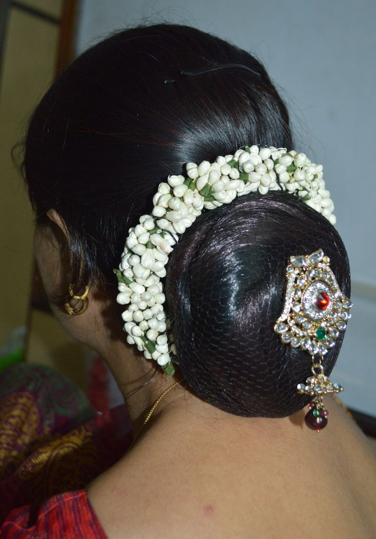 Hairstyle for saree with jasmine flower