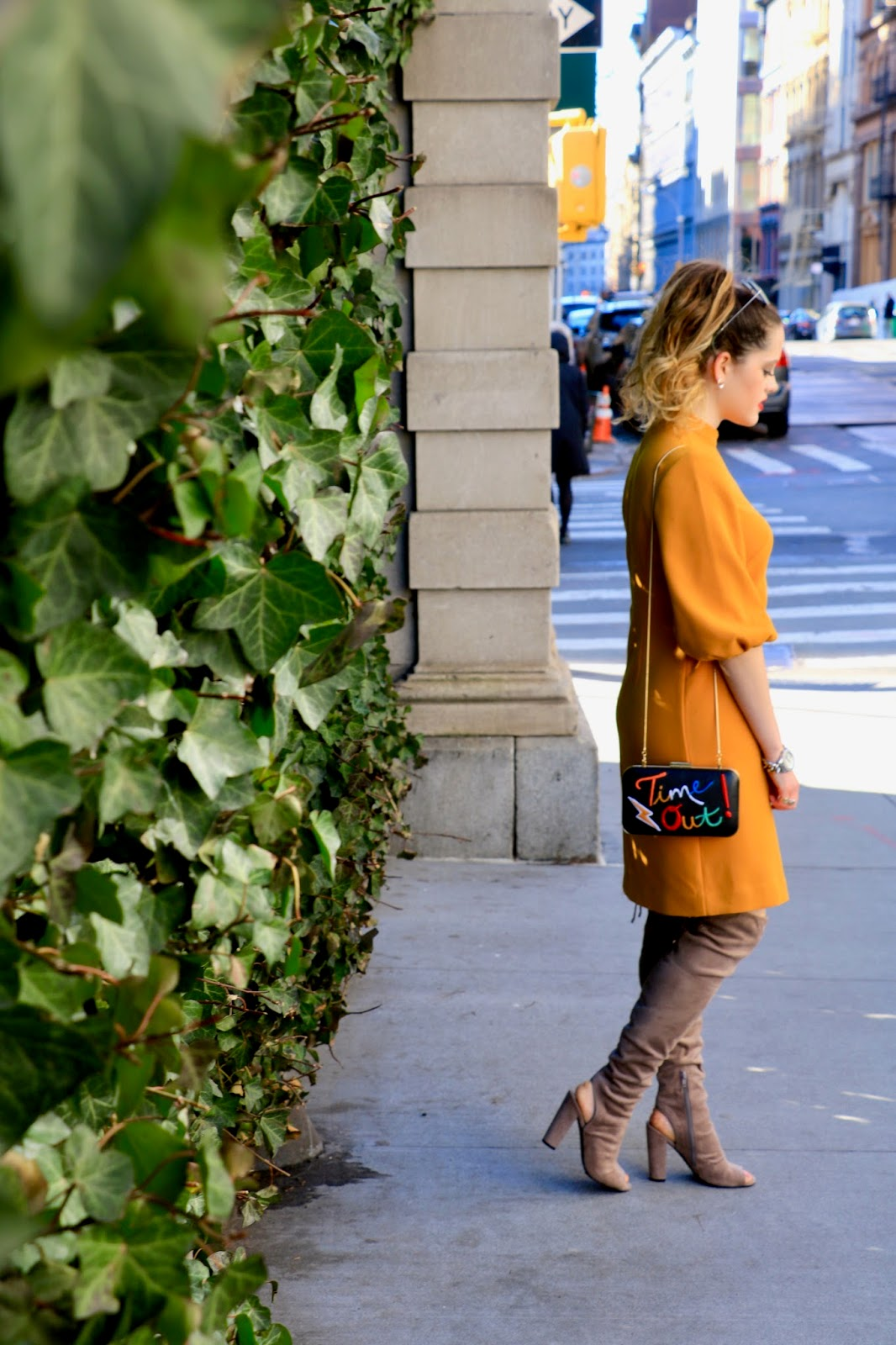 Nyc fashion blogger Kathleen Harper wearing thigh-high boots for spring