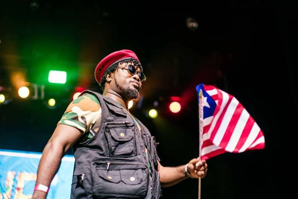 deng flies high the liberian flag at one africa music fest 2018