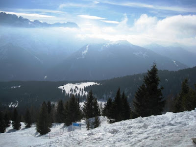 Sunshine and cloud obscuring mountains and slopes