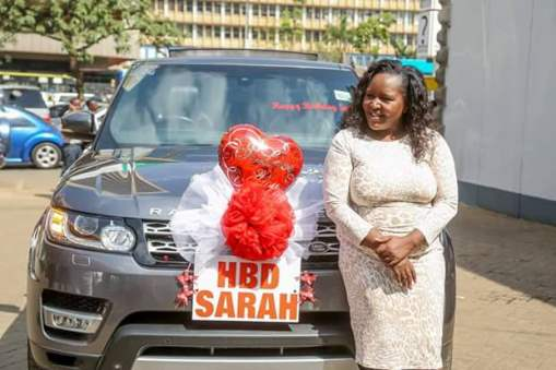 Photos: Kenyan Businessman Brings Nairobi Street To A Standstill As He Surprises His Wife With Brand New Range Rover On Her 39th Birthday