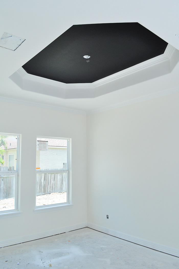 Alabaster by Sherwin-Williams in a matte sheen for walls and tricorn black for tray ceilings. | via monicawantsit.com