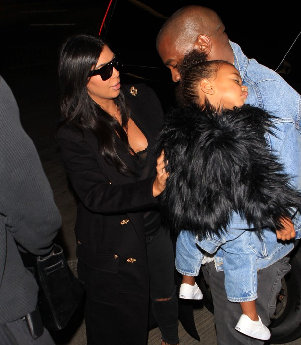 Kanye West and Kim Kardashian with her daughter in Los Angeles Airport