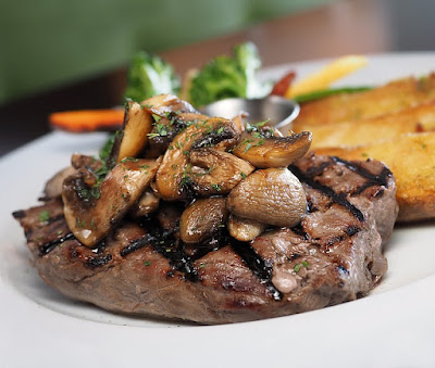 Grilled Steak Topped with Mushrooms