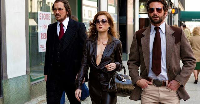 Christian Bale, Amy Adams şi Bradley Cooper în filmul American Hustle