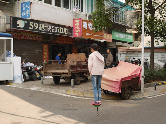girl on a pogo stick in Changsha
