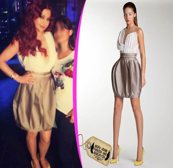 85fc6bd772 For the second prime of Your Face Sounds Familiar ( Shaklak Mesh Ghareb) Haifa  Wehbe wore this girly dress featuring a white draped top with a puffy ...