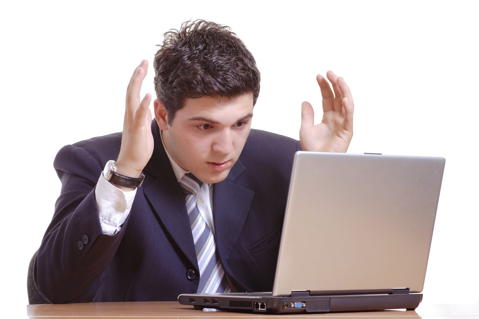 businessman frustrated with results on laptop