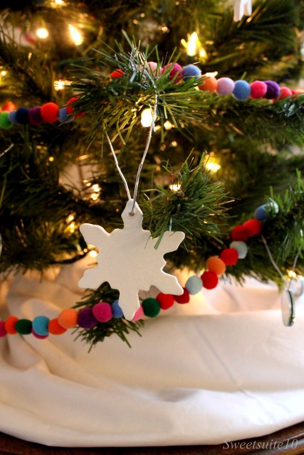 close up of a snowflake ornament in a tree